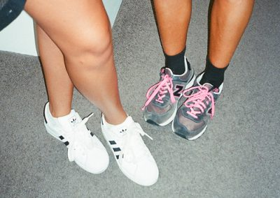 grey-and-pink-new-balance-shoes-and-black=and-white-addidas